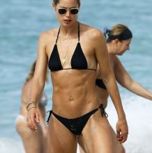 Doutzen Kroes sexy bikini bends over candids on the beach in Miami 33x HQ photos