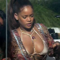 Rihanna sexy bikini cleavage candids on parties poolside at Miami beach 25x HQ photos