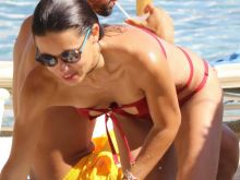 Adriana Lima sexy bikini candids on the beach in Mykonos 30x HQ photos
