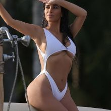 Kim Kardashian big fake ass in sexy swimsuit in Mexico 14x HQ photos