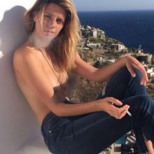 Mischa Barton topless smoking outside HQ Twitpic