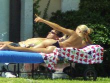 Anna Kournikova nineteen topless sunbathing 2001 April 41x HQ photos