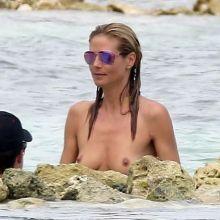 Heidi Klum topless on the beach in France 8x HQ photos