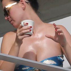 Katy Perry wearing a bikini top on the hotel balcony in Miami 11x HQ